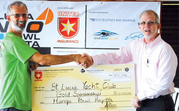 Image: (L-R) SLYC Commodore Dr. Steven King receiving sponsorship cheque from Chairman of United Insurance Anthony Bergasse (Photo: Anthony De Beauville)