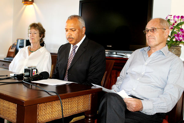The Gobats fllank their attorney Peter Foster at a November 2014 press conference. [Photo: Stan Bishop]