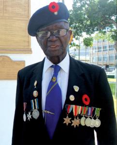 World War II veteran, Haynes Cyril, at the War Memorial in Derek Walcott Square. [Photo: Stan Bishop]