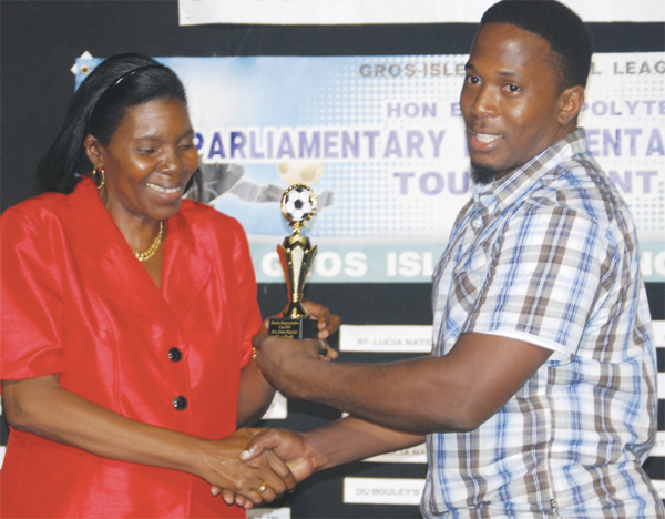 (L-R) Parliamentary representative Emma Hippolyte presenting Police Shane Paul with his award for most goals scored in the tournament.(PHOTO: Anthony De Beauville)