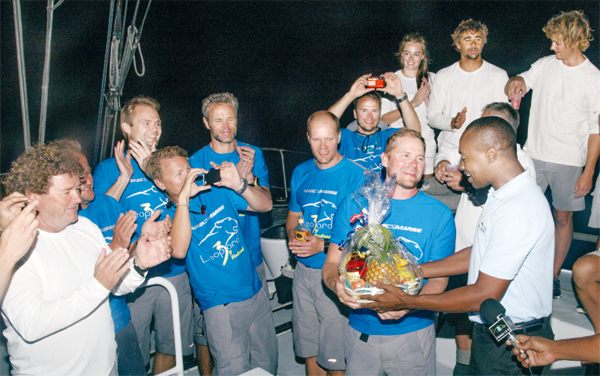 "SLTB John Emmanuel presenting an all fruit basket to the ""Leopard by Finland"" crew. (PHOTO: VOICE, Isabelle Sanka)"