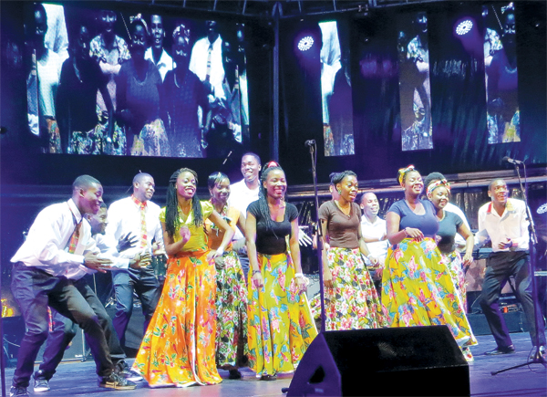 Members of JUSTUS on stage.