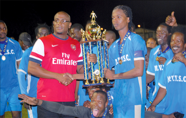 Sports Minister Shawn Edward Presenting Championship Trophy To Mabouya Valley Captain. [Photo: Anthony De Beauville]