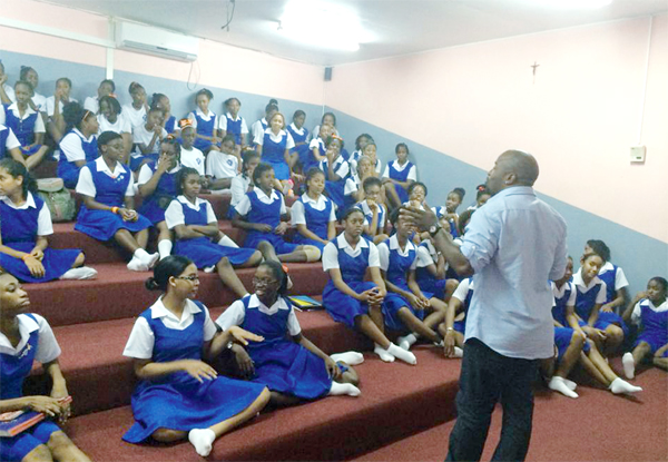 Teddyson John addressing girls at St. Joseph's Convent