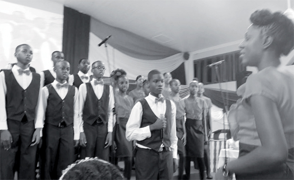 Shirley Ann Cyril-Mayers with her young chorale.