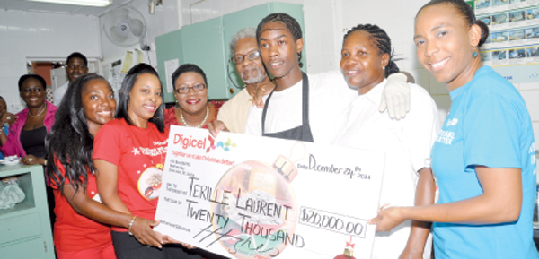 Terille Laurent (third from right) with DIGICEL and Bay Gardens pesonnel