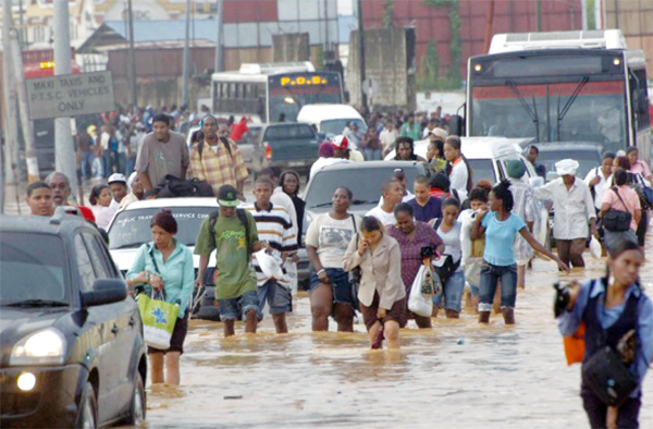 Braving floods in Trinidad.