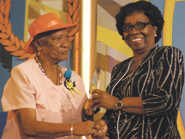 (L-R) Alicia John receiving her award from Governor General Dame Pearlette Louisy.