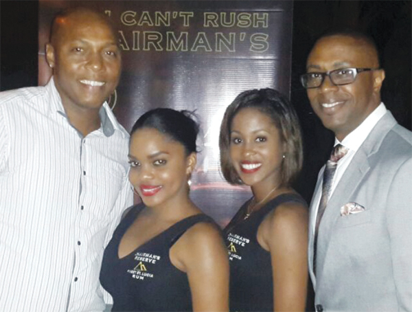 Charles (left) with Tourism Minister Lorne Theophilus and two company hostesses at the launch.
