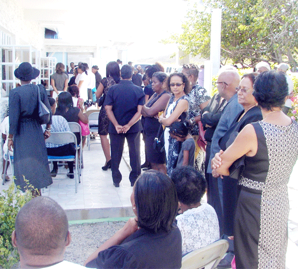 Mourners outside Rambally's funeral chapel