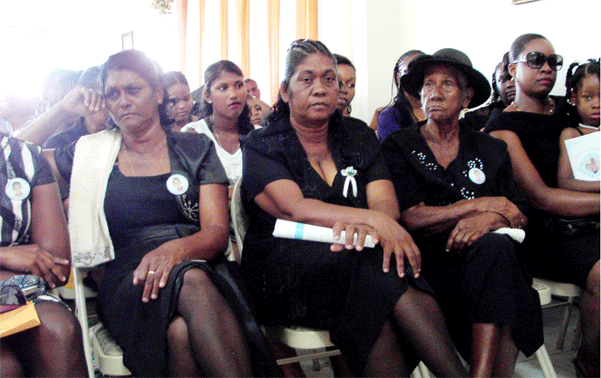 Family members at Sunday's funeral services.