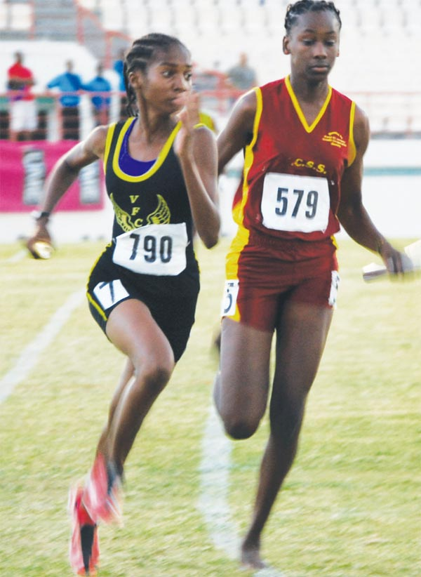 (L-R) Vieux Fort Comprehensive and Soufriere Comprehensive set the tone for the relay races. [Photo: Anthony De Beauville]