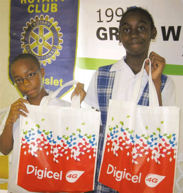 Nathan Sherman and Letana Bruneau of the Montessori Centre receive their prizes.