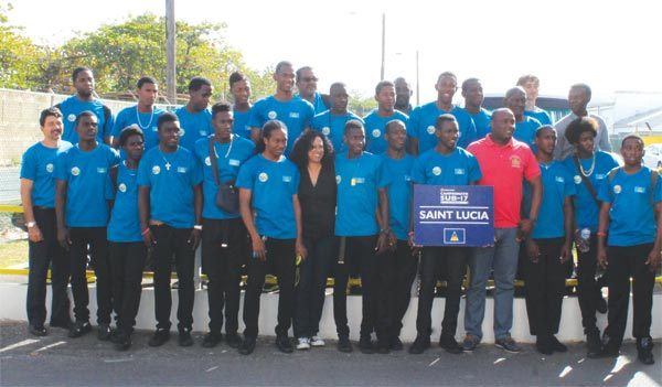 Picture moment for National Under - 17 football team and St. Lucia Minister for Youth Development and Sports Shawn Edward on arrival. [Photo: Anthony De Beauville]