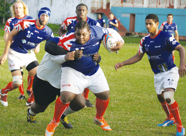St. Lucia and BVI big men testing their strength in action. [Photo: Anthony De Beauville]