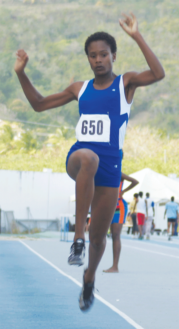 St. Joseph's Convent Nysa Pierre wins girls long jump with a distance of 5.18 metres. [Photo: Anthony De Beauville]