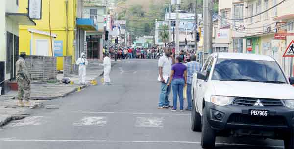 Chaussee road crime scene attracts attention. [Photo: Stan Bishop]