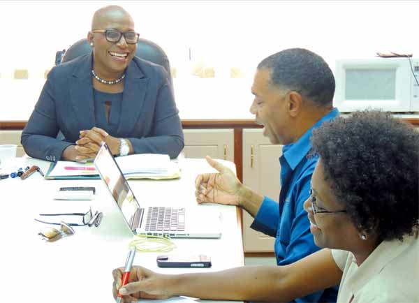 Dr. Rigobert, Augier and Louisy in a light moment