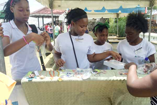 Junior Achievers manning a booth during Jazz on the Square.