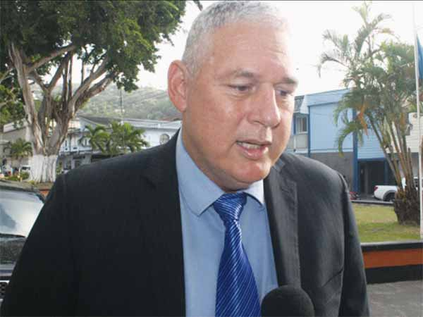 UWP Political Leader, Allen Chastanet, speaks with reporters outside the House of Assembly last Tuesday. [Photo: Stan Bishop]