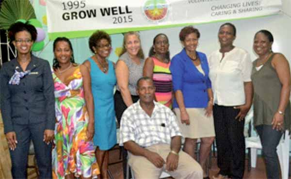 Grow Well's Executive Council: Paul Lorde, President (Center). From left to right - Monique Dubisson, Christina Jules, Colleen Newman, Tracey Arnold, Ancillia Louis, Mauricia Francis, Ruth Lastic, Karleen Edwin.