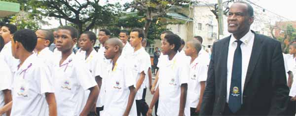 St. Mary's College principal, Rowan Seon, and his students marching around Derek Walcott Square twice last Sunday afternoon.