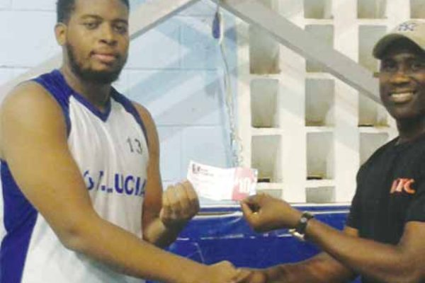 Image: Combined Schools Parkel Gumbs who scored 14 points, 7 rebounds receiving his KFC Player of the Game award from SLBF PRO Neil Joseph.