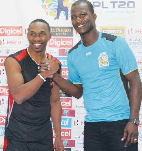 """Image: (L-R) Trinidad and Tobago Red Steel's Dwayne Bravo and St. Lucia Zouks' Darren Sammy say: """"Let the game begin"""". (Photo: Anthony De Beauville)"""