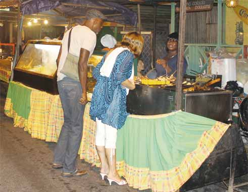 Image: A typical Friday night street party scene in Gros Islet. (Photo: Stan Bishop)
