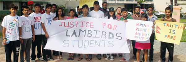 Former Lambirds Academy students protesting in Constitution Park . [Photo: Stan Bishop]