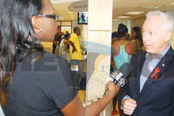Image of Scotiabank's Phillip Cross speaking to reporters last Friday. [PHOTO: Stan Bishop]