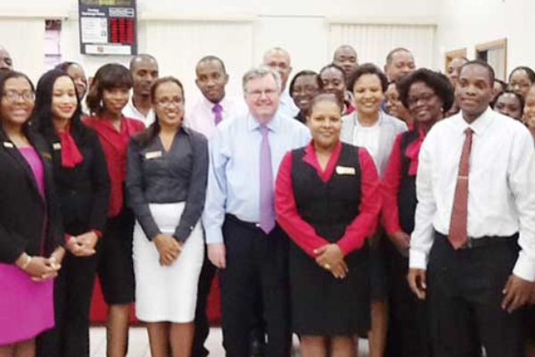 Image of FirstCaribbean CEO, Rik Parkhill (centre) with employees at Bridge Street Castries.