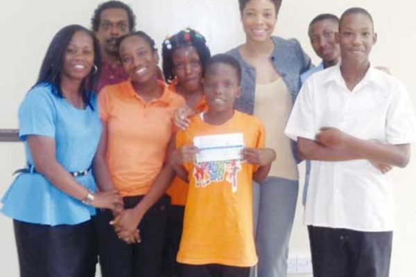Five Dunnottar School students accompanied by two teachers (far left) and LIME Marketing Executive, Sharlene Jn. Baptiste