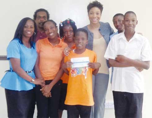 Five Dunnottar School students accompanied by two teachers (far left) and LIME Marketing Executive, Sharlene Jn. Baptiste