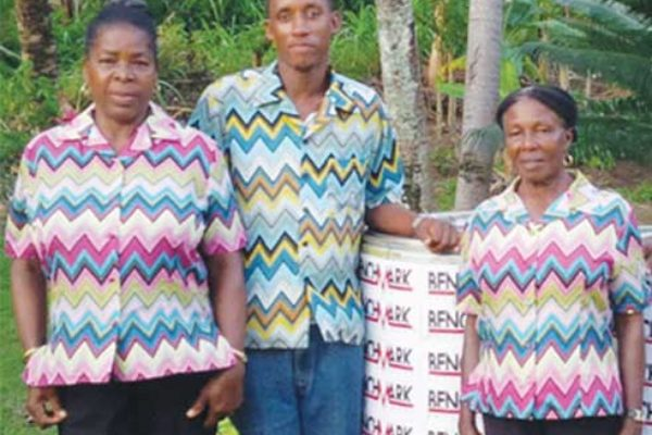 Image: Members of the Babonneau Mothers & Fathers Group receiving two Barrels of items from Benchmark Entertainment