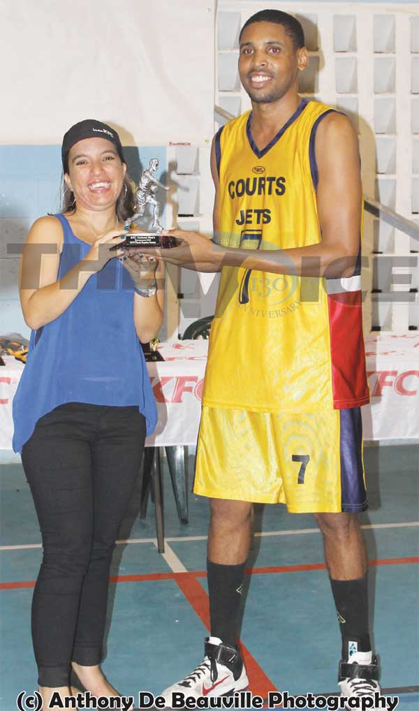 Image of MVP of the Final Keegan Preville receiving his award from KFC Marketing Officer Dionne Gardner. (Photo: Anthony De Beauville)
