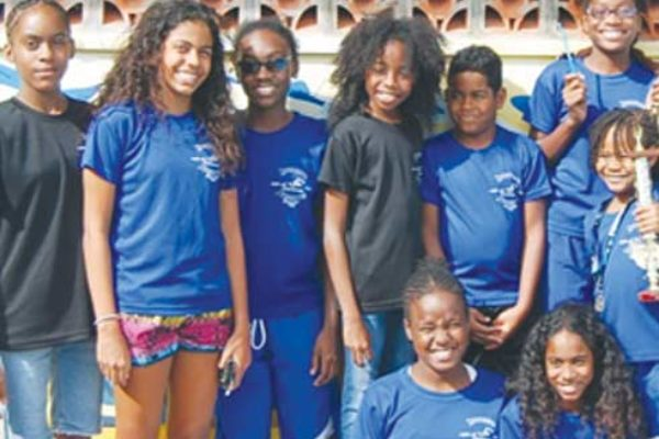 A photo moment for the inaugural champions Lightning Aquatic Swim Club and Dr. Christopher Beaubrun first from right.