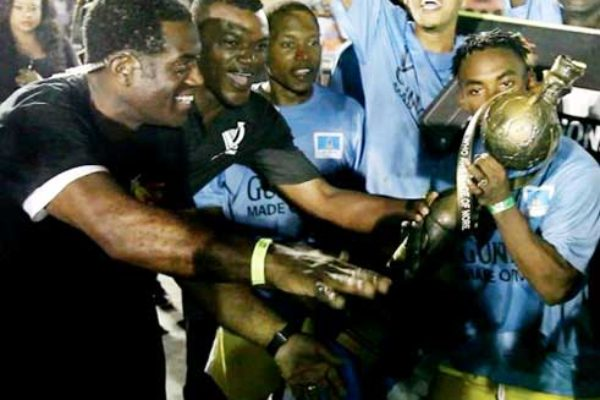 Image of an elated Veterans captain Romiel Felix with the Championship trophy.
