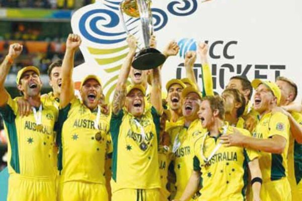 Image of fifth time champions...Michael Clarke and the Australia team celebrate with the World Cup trophy (PHOTO Getty Images Cameron Spencer)
