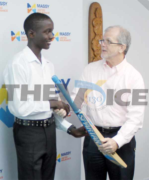 (L-R) Prolific run scorer Kimani Melius receiving a brand new bat from Chairman of United Insurance Ltd Anthony Bergasse (Photo: Anthony De Beauville)