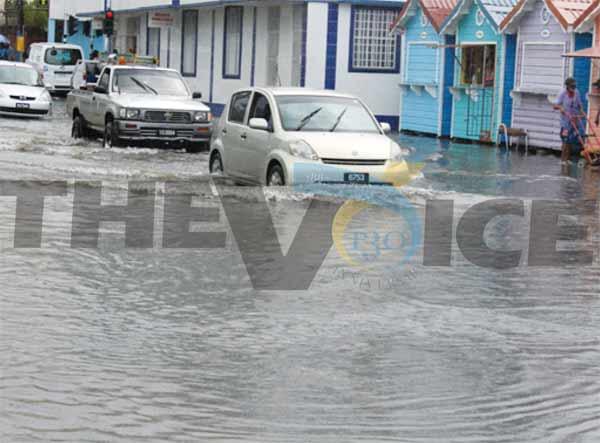 Flood waters on Jeremie Street, Castries following heavy rainfall. [Photo: Stan Bishop]