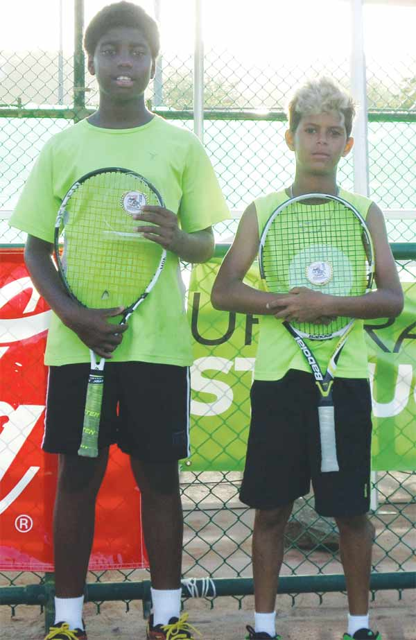 (L-R) Doubles Boys champions St. Lucia Maxx William and Jordan Hunte. [Photo: NTC]