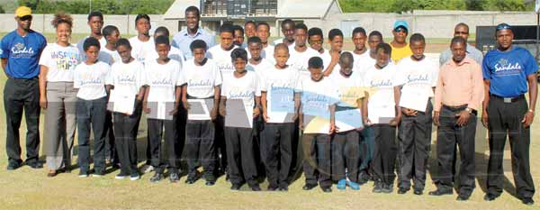Photo moment for the 26 participants along with Darren Sammy, Sandals representative, Ministry for Youth Development and Sports representative and coaches. (PHOTO: Anthony De Beauville)