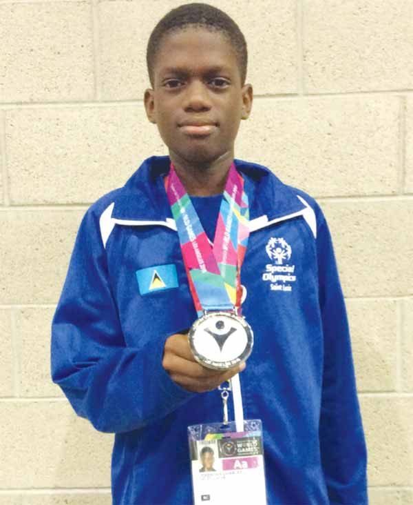 Silver for Jeremiah Charles in Bocce. [Photo: ASt. Lucia Special Olympics]