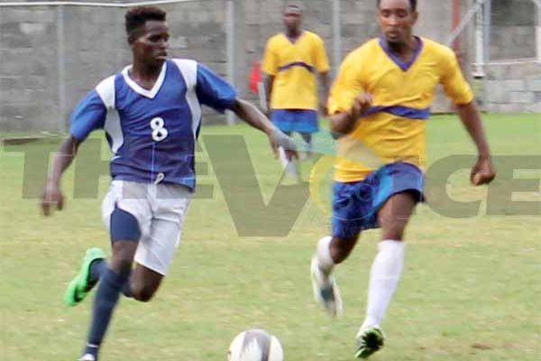 SOme of the action between defending Canaries and Gros Islet on Saturday. (Photo Anthony De Beauville)