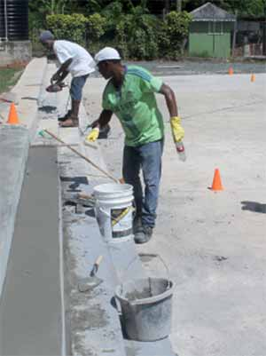 Work in progress at the Fond Assau Combined School court. [Photo: Anthony De Beauville]