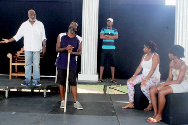 "Alvin Hippolyte (far left) and Kennedy ""Boots"" Samuel (second from left) rehearsing their lines at Samaana Park last Saturday. [Photo: Stan Bishop}"