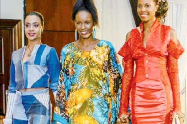 Charlery (centre) with models showing off her designs.