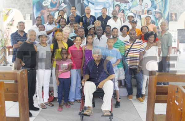 Derek Walcott, St. Omer family members and other well-wishers. [Photo: Stan Bishop]