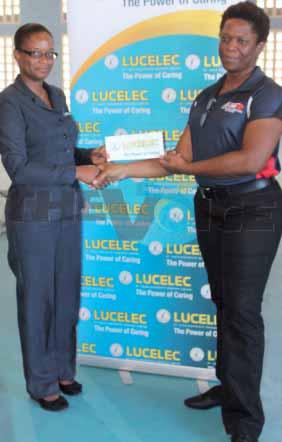 (L-R) LUCELEC's Representative Bernardia Regis Presenting School Sports Coordinator Isabelle Marquis with the $50, 000.00 sponsorship cheque (Photo: Anthony De Beauville)